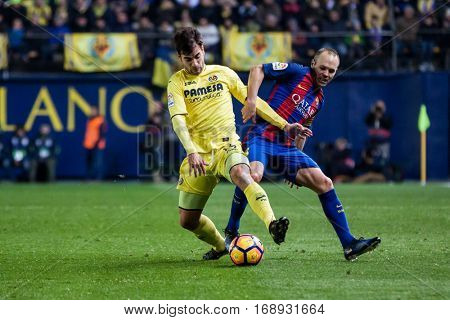 VILLARREAL, SPAIN - JANUARY 8: (L) Trigueros and Iniesta during La Liga soccer match between Villarreal CF and FC Barcelona at Estadio de la Ceramica on January 8, 2016 in Villarreal, Spain