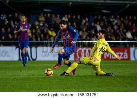 VILLARREAL, SPAIN - JANUARY 8: Leo Messi with ball during La Liga soccer match between Villarreal CF and FC Barcelona at Estadio de la Ceramica on January 8, 2016 in Villarreal, Spain