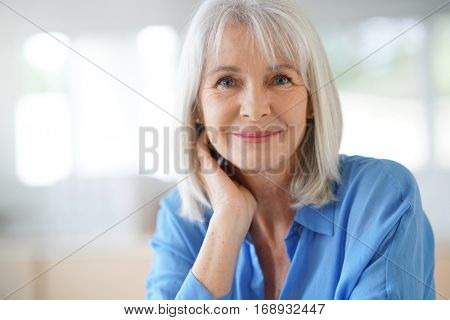 Portrait of senior woman with blue shirt