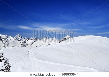Off-piste Slope For Freeriding With Track From Snow Grooming In Sun Winter Day