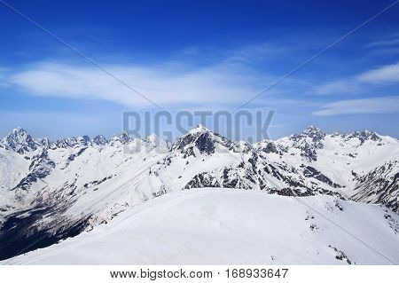 Mountain Peaks And Off-piste Slope For Freeriding In Sun Winter Day
