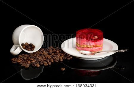 Saucer With Cakes And Poured Coffee Beans With Mugs On Black.
