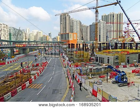 Hong Kong, China - February 13, 2016: Large construction site of West Kowloon Terminus Station in Hong Kong for the Guangzhou-Shenzhen- Hong Kong Express Rail Link (XRL). It is the only station in Hong Kong, which is to be connected to the Chinese network