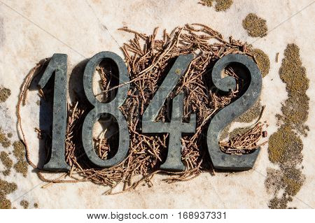 closeup of number or date 1842 old style numbers