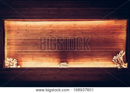 Wooden bamboo planks niche with warm orange light along the perimeter and copy space