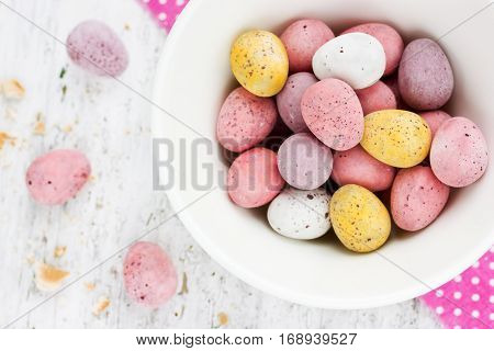 Chocolate candy mini eggs - traditional sweet treats for kids on Easter holiday