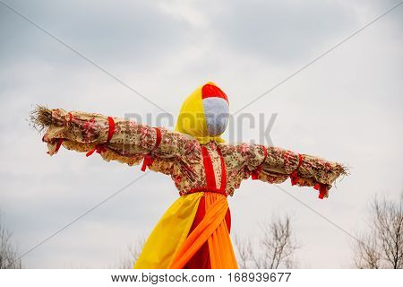 Close-Up Straw Effigy Of Dummy Of Maslenitsa, Symbol Of Winter And Death In Slavic Mythology, Pagan Tradition. The Eastern Slavic Religious, Folk Holiday Celebrating Up To Now Before Great Lent.