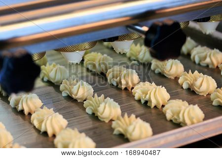 Close up of automated biscuit cookies shape forming machine. Selective focus.