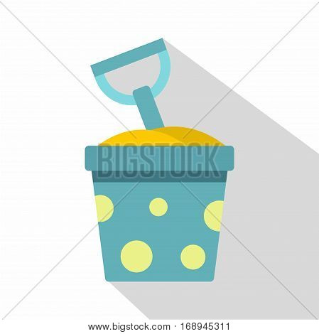 Blue bucket of sand and shovel icon. Flat illustration of blue bucket of sand and shovel vector icon for web   on white background