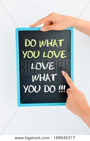 Do what you love and love what you do text on blackboard suggesting working with passion