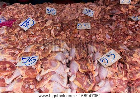 Raw chicken meat and offal in asian market