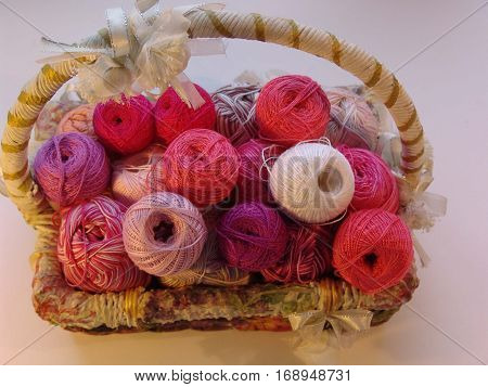 Basket. Pink accent. Colored balls of yarn. Valentine. All colors.