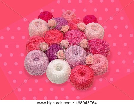 Pink accent. Colored balls of yarn. Valentine. All colors.