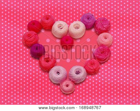 Pink accent. Colored balls of yarn. Valentine