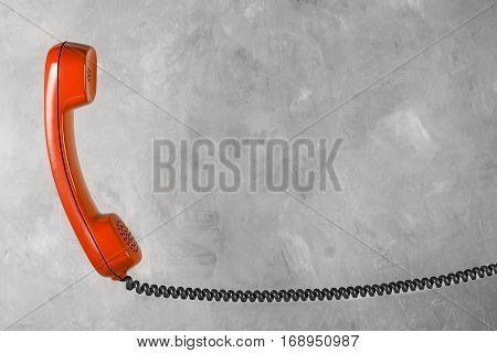 Red Handset From Landline Phone On The Background Wall