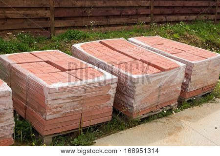 Pallets With Red Concrete Paving Slabs