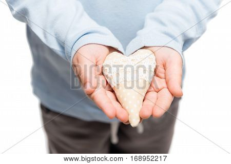 Heart in hands of little kid. Isolated on a white background