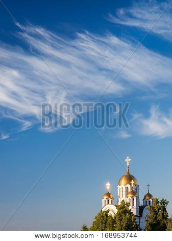 Orthodox church at sunset with a cloudy sky as copy space. Samara Russia