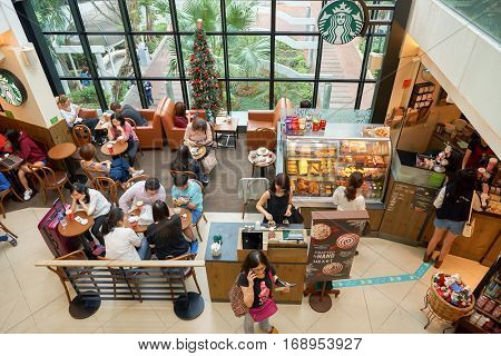 HONG KONG - CIRCA NOVEMBER, 2016: a Starbucks cafe in Hong Kong. Starbucks Corporation is an American coffee company and coffeehouse chain.