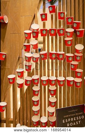 HONG KONG - CIRCA NOVEMBER, 2016: Christmas decorations at a Starbucks cafe in Hong Kong. Starbucks Corporation is an American coffee company and coffeehouse chain.