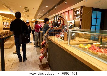 HONG KONG - CIRCA NOVEMBER, 2016: inside a Starbucks cafe in Hong Kong. Starbucks Corporation is an American coffee company and coffeehouse chain.