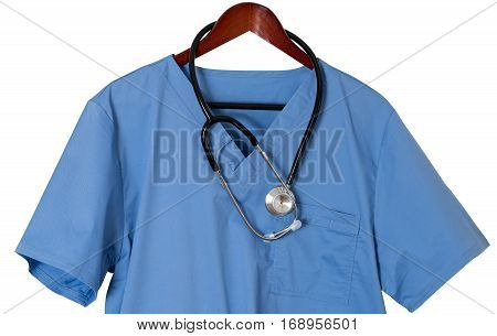 Blue medical scrubs uniform shirt hanging on a hanger with stethoscope with path and isolated against white background