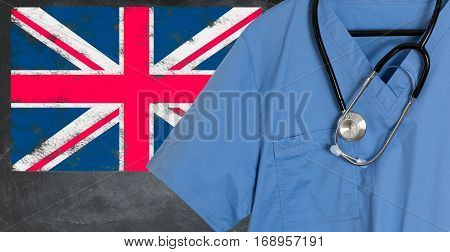 Blue doctor scrubs shirt and stethoscope hang empty in front of British flag. Illustration of medical staff coming from other countries to staff national health service