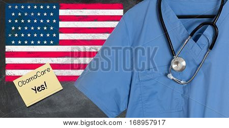 Blue doctor scrubs shirt and stethoscope hang empty in front of USA flag. Illustration of healthcare system problems with question about ObamaCare replacement