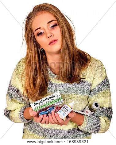 Woman holding nasal spray, remedy, packaging pill and tablet. Colds and flu as well as other diseases injurious to health. Adult human with temperature press medicine with labels.