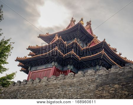 Beijing, China - Oct 30, 2016: View of Jiaolou Tower, Forbidden City (Gu Gong, Palace Museum). This ancient watch tower is along Donghuamen Road. Close view directly from under of outside wall.