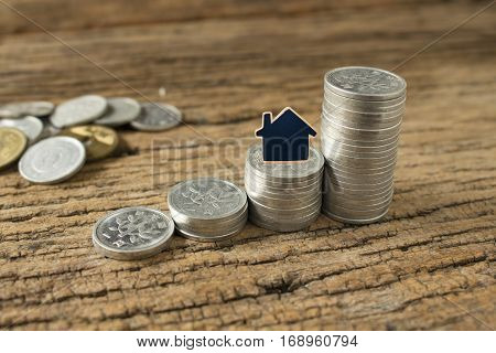 stack coin of japan with small house model,concept idea for save money.