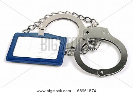 Handcuffs with chain and name tag on a white background