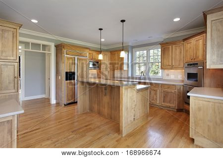 Kitchen in upscale home with double decker island.