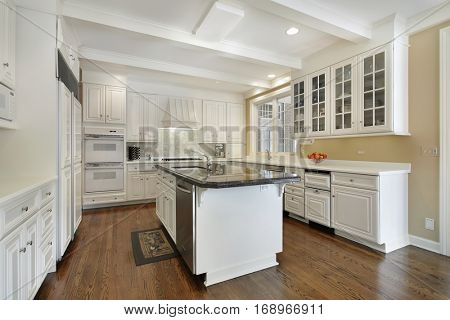 Kitchen in upscale home with white cabinetry.