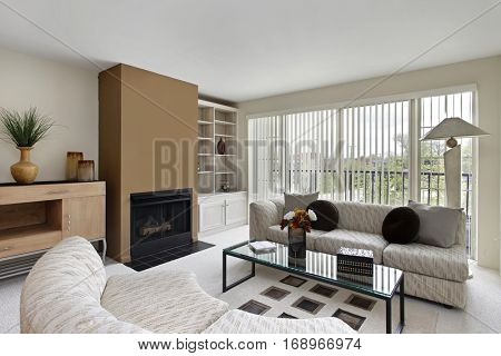 Living room in condominium with fireplace