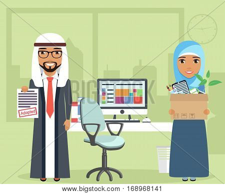 Concept employment. The guy and the girl Arabs. Young girl holding a box with personal belongings. Workplace in office. Happy people.
