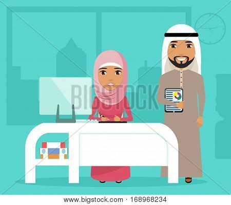 A young girl and a young man at work in the office. The girl and the guy Arabs. The concept of teamwork. Working space. Happy people.