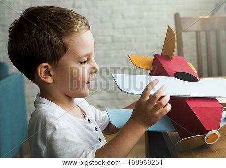 Little Boy Playing Aeroplane Toy