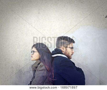 Girl showing the back to the boyfriend angrily
