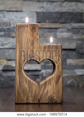 Lit romantic wooden candle holder with cut heart