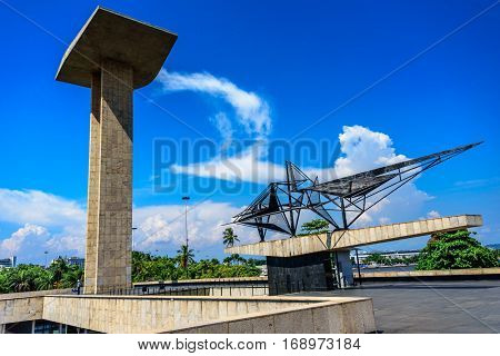 RIO DE JANEIRO, BRAZIL - JANUARY 07, 2017: Concrete portal sculpture and metal sculpture of the National Monument to the Dead of the Second World War with beautiful sky and clouds on the background