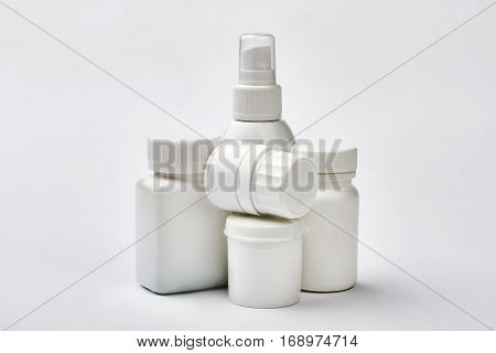 White plastic drug boxes. Medicine in containers. Remedy for allergy.