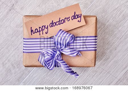 Happy Doctor's Day present box. Greeting card and bow. Congratulations for doctor.