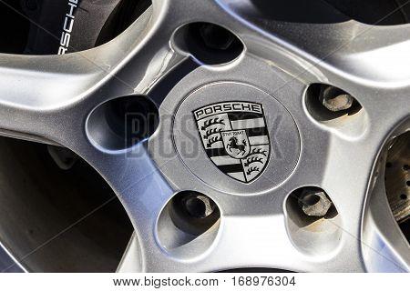 Indianapolis - Circa February 2017: Traditional Porsche Wheel Logo on a new 911. Porsche Racing Dates to the 1950s III