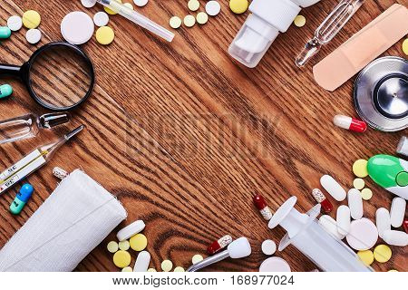 Medicines and tools on wood. Empty space for your advertisement.
