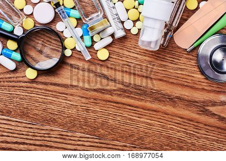 Pills and medical tools. Advertisement of medicine production.