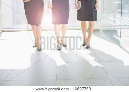 Cropped version of Business women in office