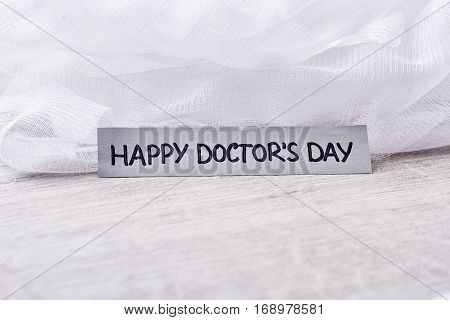 Medical bandage on white background. Happy celebration of Doctor's Day.