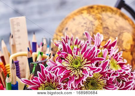 World globe, stationery and flowers. In the world of travel.