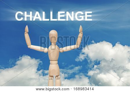 Wooden dummy puppet on sky background with word CHALLENGE. Abstract conceptual image